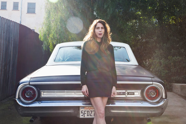 "Rachel Kushner, author of ""The Flamethrowers,"" with her 1964 Ford Galaxie 500 in an alleyway near her home in Los Angeles"